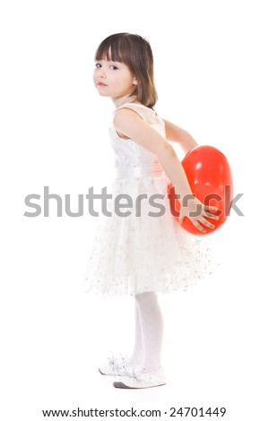 Little girl with red heart-shaped balloon behind her back