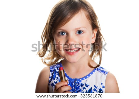 Little girl with red lipstick isolated on white background - stock photo