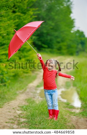 little girl with red umbrella