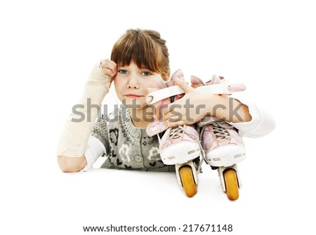 Little girl with roller skates and broken arm. Isolated on white background  - stock photo