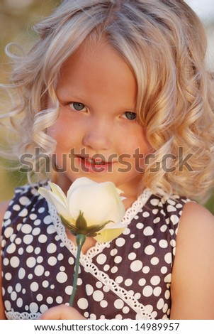 Little girl with rose. - stock photo