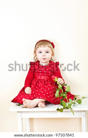little girl with rose - stock photo