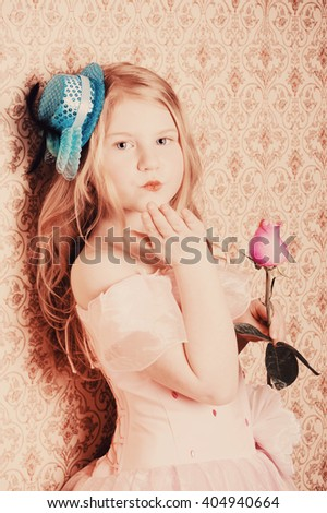 little girl with rose on background wallpaper - stock photo
