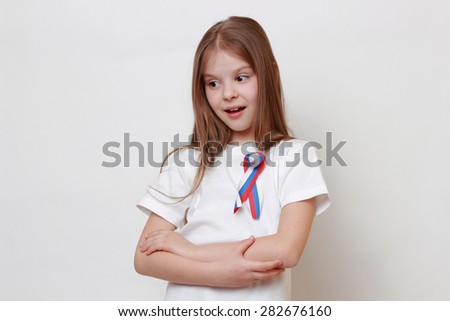 Little girl with russian flag ribbon