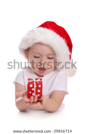 Little girl with santa hat and red gift box isolated on white background - stock photo