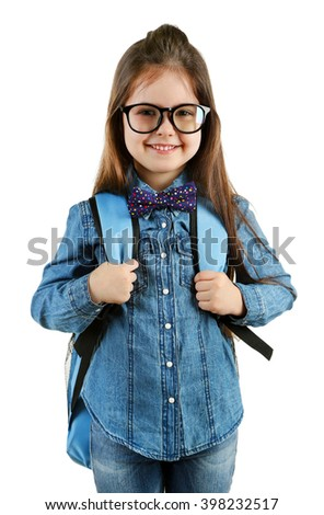 Little girl with school backpack isolated on white
