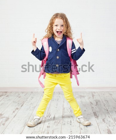 Little girl with schoolbag. Happy child at home - stock photo