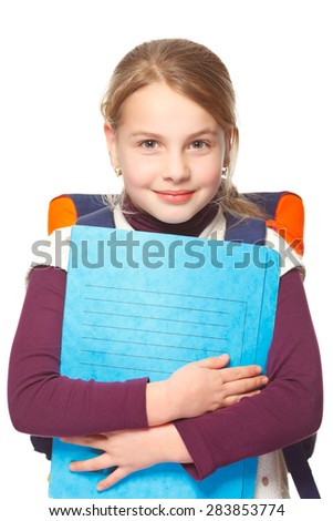 little girl with schoolbag holding folders and smiling - stock photo