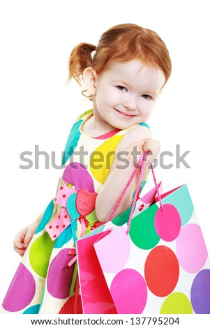 little girl with shopping bag cheerful shopaholic - stock photo