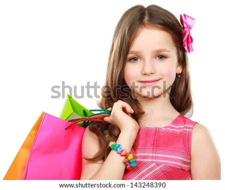 little girl with shopping bags over white background - stock photo