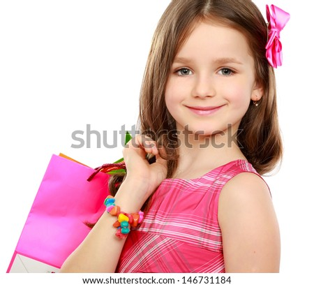 little girl with shopping bags over white background