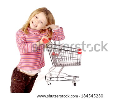 little girl with shopping cart - stock photo