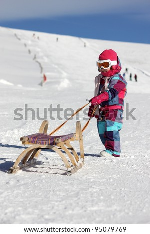 Little girl with sled