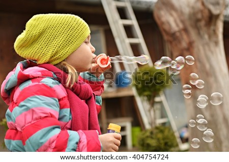 little girl with soap bubbles - stock photo