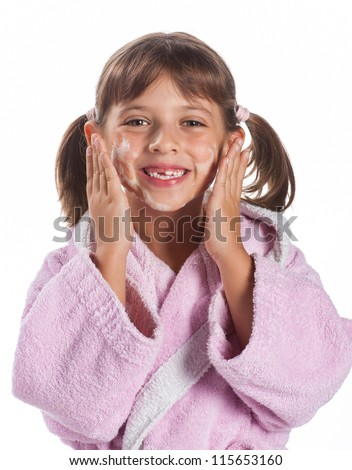 little girl with soapy face