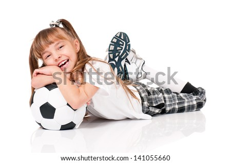 Little girl with soccer ball lying on floor, isolated on white background - stock photo
