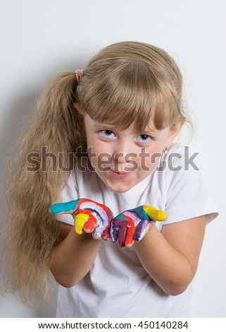 little girl with stained in vivid colors palms - stock photo