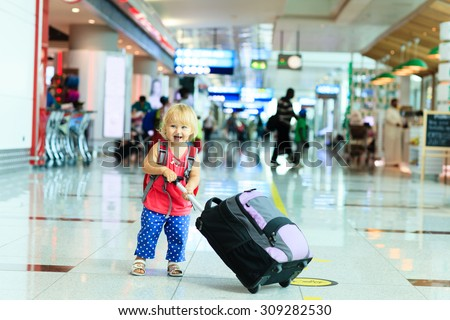 little girl with suitcase travel in the airport, kids travel - stock photo