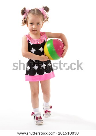 Little girl with the ball on white background.happy childhood,sweet child having fun outdoor,playing isolated on white background, happiness concept,adorable child having fun in studio - stock photo