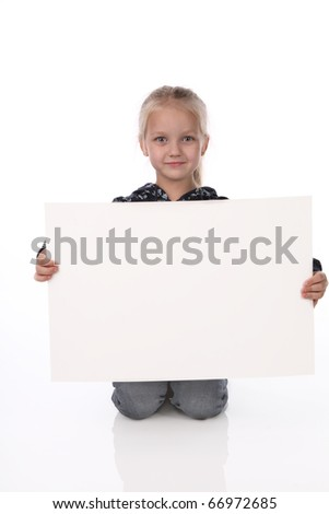little girl with the big pure clean sheet of a paper - stock photo