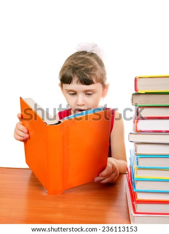 Little Girl with the Books at the Desk on the White Background