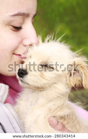 Little girl with the puppy - stock photo