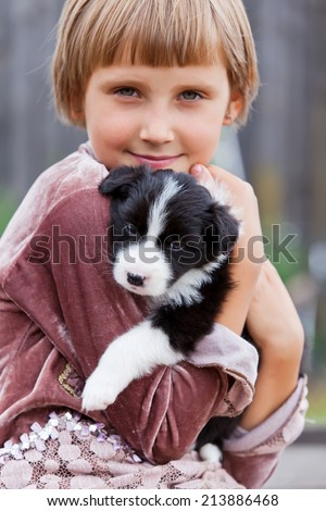 Little girl with the puppy Border Collie