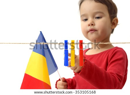 little girl with the romanian flag on white background - stock photo