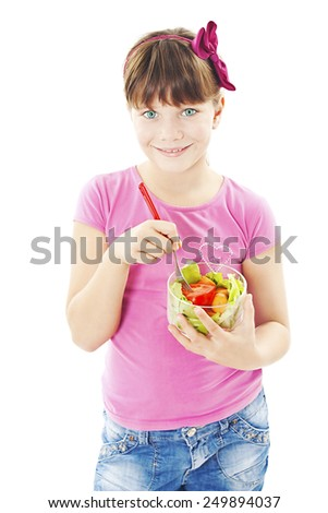 Little girl with the vegetables - healthy food concept. Isolated on white background
