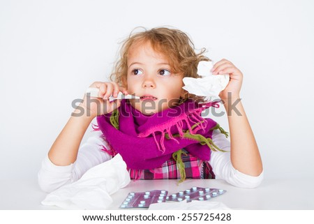 little girl with thermometer - stock photo