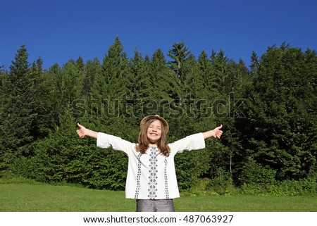 little girl with thumbs up enjoy in nature