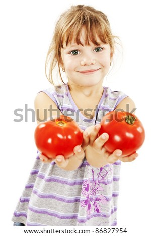 Little girl with tomatoes.  Isolated on white background - stock photo