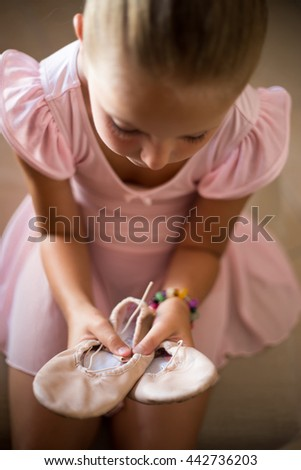 Little girl with tutu ballet focuses on the essay