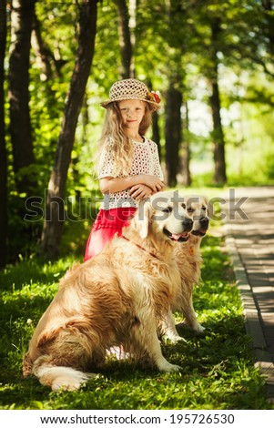 Little girl  with two dogs outdoors  - stock photo