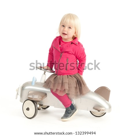 Little girl with vintage airplane bike - stock photo