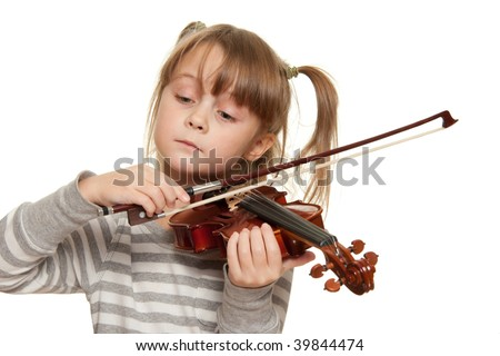 Little girl with 1/16 violin. - stock photo