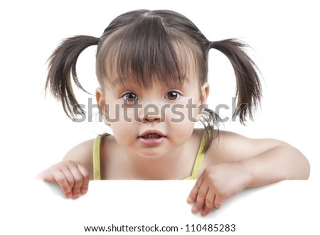 Little girl with white banner looking at camera