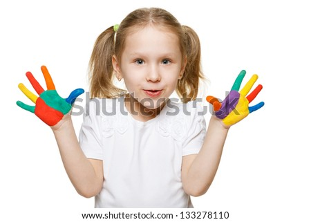 Little girl with with the palms painted by a paint - stock photo