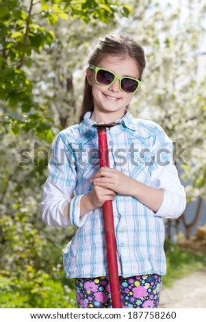 Little girl working in the garden