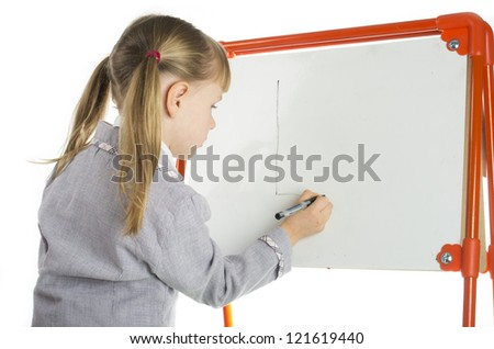 Little girl writing at whiteboard - stock photo
