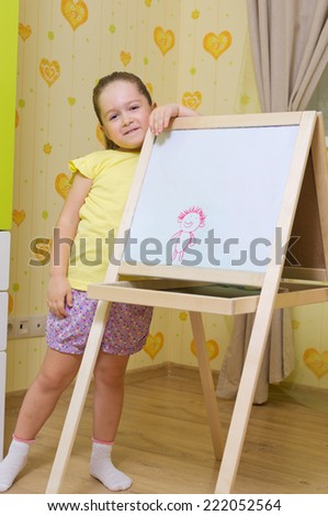 Little girl writing on the whiteboard - stock photo