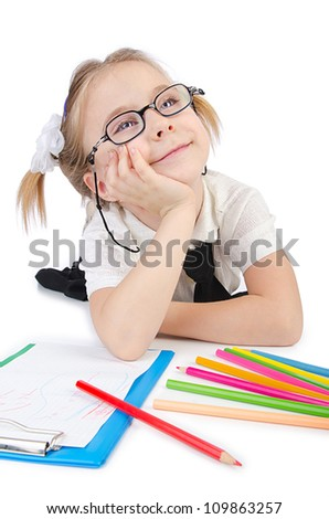 Little girl writing with pencils
