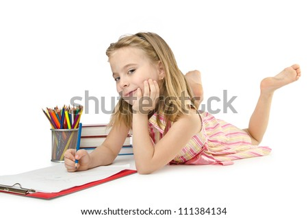 Little girl writing with pencils - stock photo
