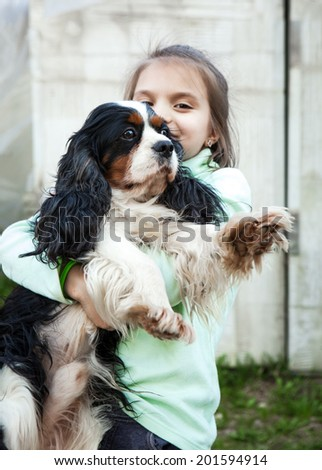 little girl 6 years old and the dog - stock photo