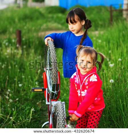 Little girls Bicycle repair on the outdoors.