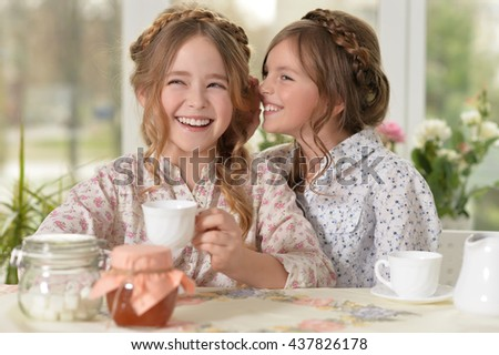little girls drinking tea