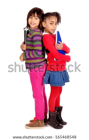 little girls holding school books isolated in white - stock photo