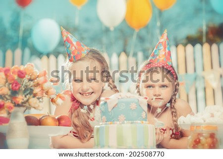Little girls in anticipation of the holiday - stock photo