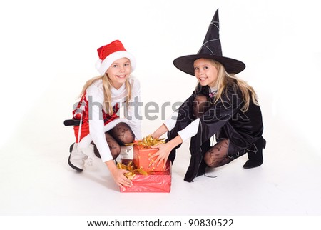 little girls in celebratory costumes holding a box - stock photo
