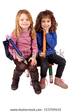 little girls isolated in white with big pencil
